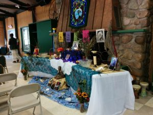 Altar with African deities on it. Mother Gaia hanging on the tapestry above. This altar was there all weekend.