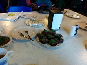 Gluten free brownies with frosting and a mint leaf. It was very good!