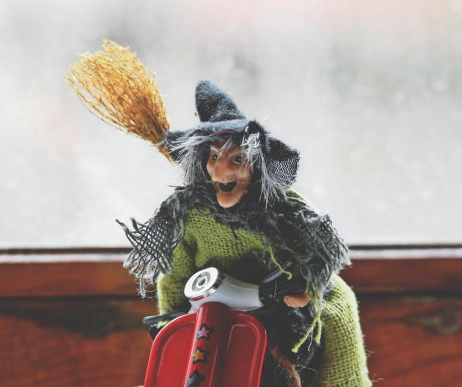 figurine of a green faced witch