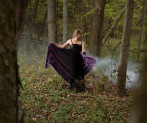 women in the forest with a shawl and fog