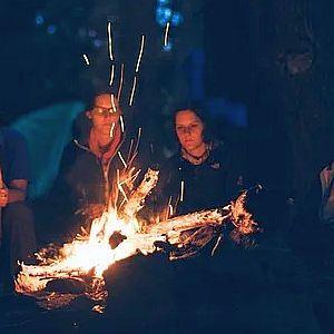 women at campfire
